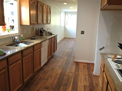 kitchen floors with oak cabinets gray laminate flooring with oak cabinets 8097