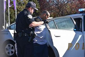 Police say suspect hit police car, 2 parked cars while ...