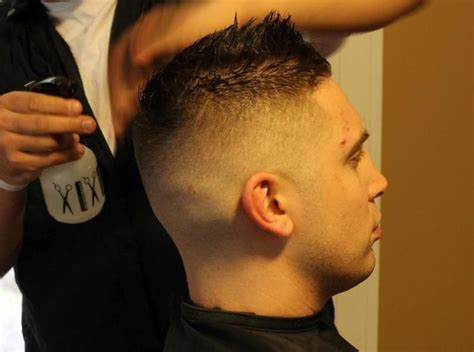 man   chair  fade faux hawk barbershops pinterest faux hawk haircuts  barbershop