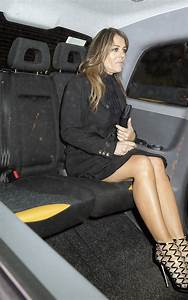 Elizabeth Hurley flashes her lithe limbs in an LBD and ...
