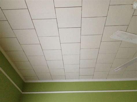 sagging ceiling tiles   fasten