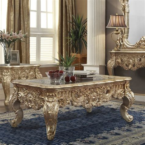 Seal the deal by placing your couch around a glass top coffee table. HD 998G Homey Design Coffee Table Victorian Style Metallic Gold & Silver Blend