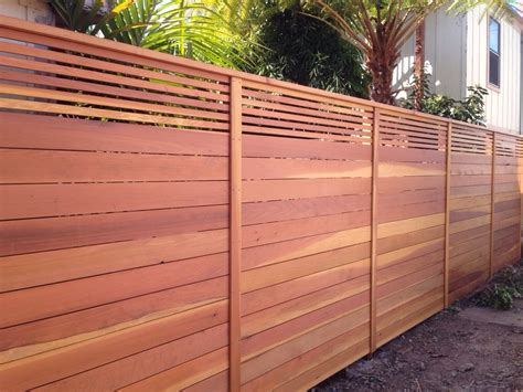 pictures of horizontal fences aanco fence custom horizontal fence with picket accent top stained natural spring valley