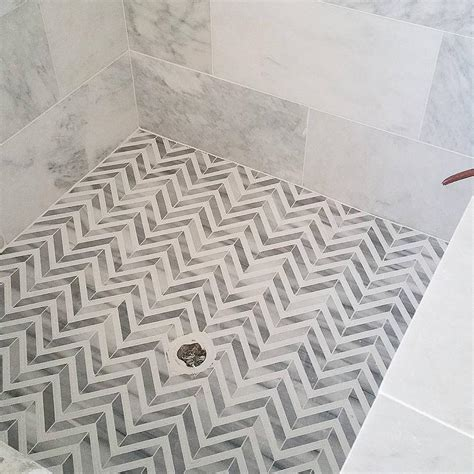 herringbone marble floor white and gray marble herringbone shower floor transitional bathroom