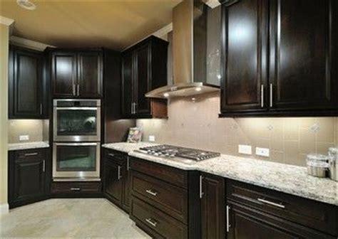 cambria bellingham  espresso cabinets light floors  similar    kitchen