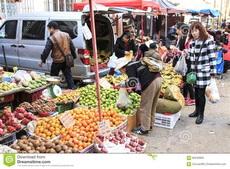 People Selling And Buying In A Traditional Market In The