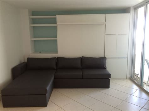 White Murphy Bed by Furniture White Wooden Murphy Bed With Green Sofa And