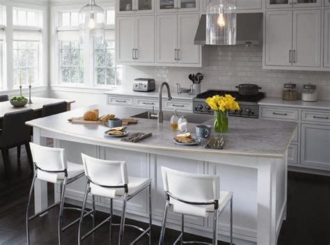 """A """"living triangle"""" kitchen featuring Formica® Laminate in"""