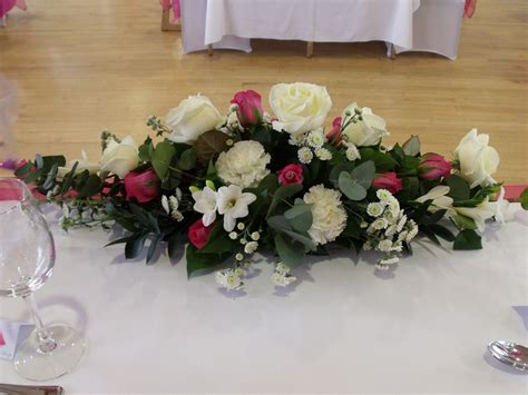 white flower table l low and long top table flower arrangement decorations