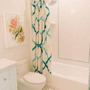 Mint green bathroom vanity with mint green dot tiles for Turquoise and pink bathroom