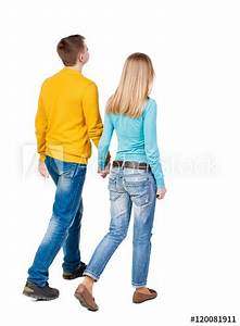 """""""Back view going couple. walking friendly girl and guy ..."""