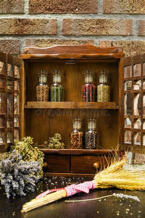 vintage wooden spice rack  storage cabinet   glass bottles stock photo image  glass