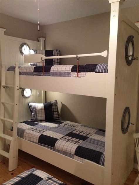 nautical bunks  portholes reading lights  oars