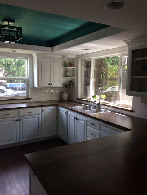 kitchen with white cabinets white subway tile and countertops made from formica 180fx black