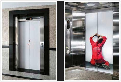 creative advertising ideas   elevator doors stickers