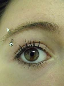 Close Up On Her Eyebrow Piercing