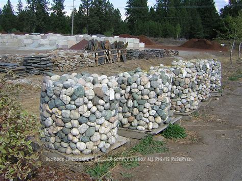 designing creek or river rock bed landscaping