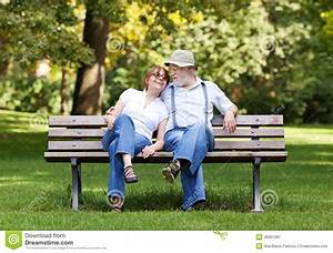 Senior Couple Sitting On A Park Bench Stock Image - Image ...