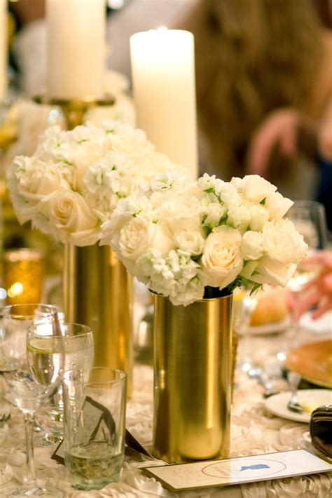 white and gold centerpieces white rose and hydrangea centerpieces in gold vases