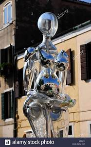 A Glass Sculpture Of A Human Figure From Murano Glass In