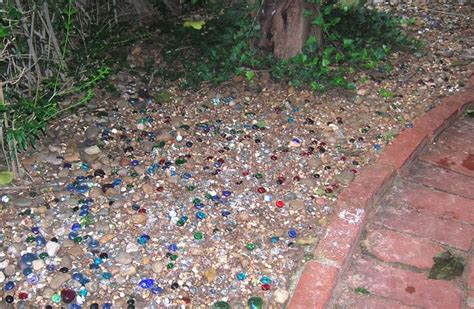 coloured gravel for gardens pea gravel mixed with colored glass stones backyard pinterest stones backyards and walkways