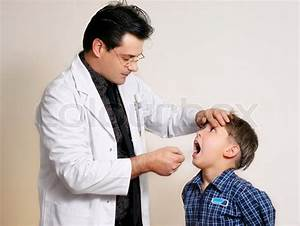 Doctor Assessing A Young Child Patient