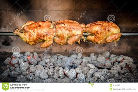 chicken cook time grill cooking rotisserie chicken on the grill with charcoal and brique stock photo image 61337397