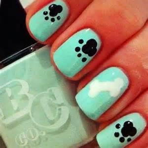 Aqua dog nail art use a dotting tool and make three dots
