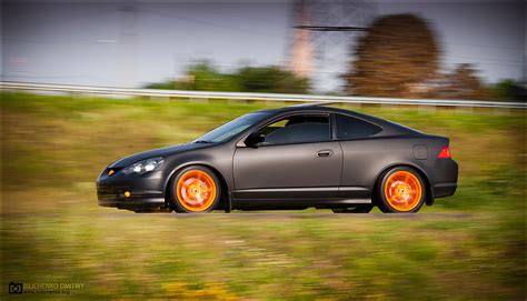 murdered out cars flat black acura rsx with orange wheels