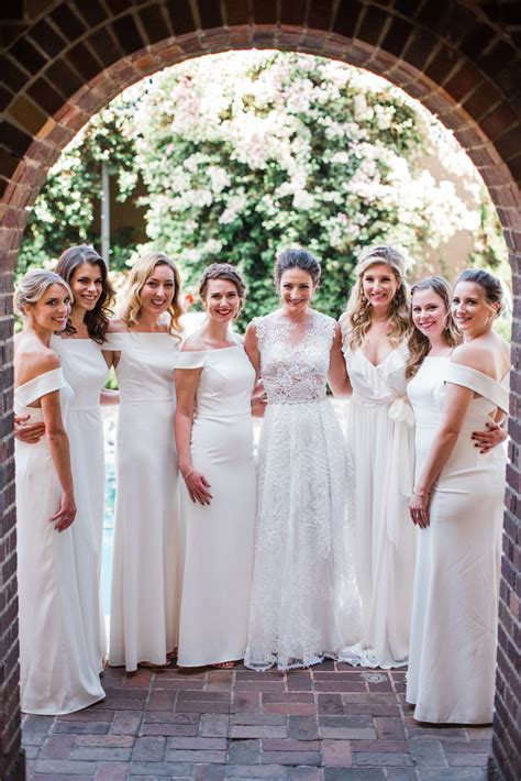 chic bridal parties wearing  white dresses martha