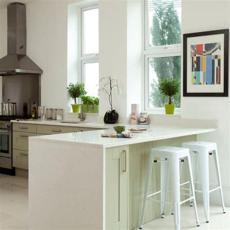 white  pale green kitchen peninsula kitchen