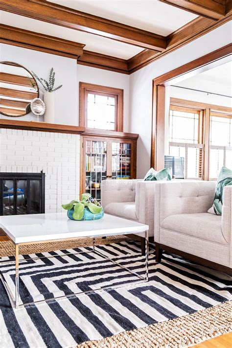 white painted brick natural wood trim neutral chairs
