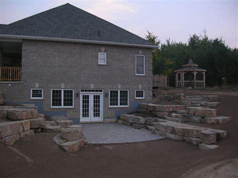 basement walkout walkout basement with limestone tiered retaining walls