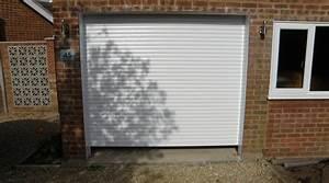 Prix d39une porte de garage enroulable cout moyen tarif for Prix porte garage enroulable motorisée