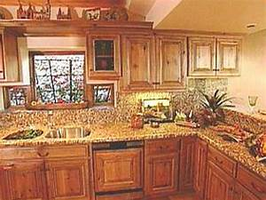 Natural style graces southwest kitchens hgtv for What kind of paint to use on kitchen cabinets for bar themed wall art