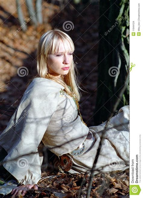 beautiful medieval woman sitting  forest stock images