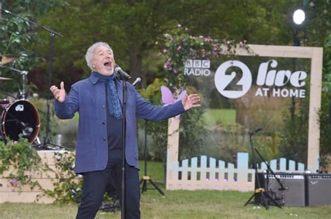 Tom Jones, 80, seen in face mask in rare outing as he ...