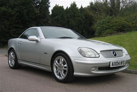 The cd changer is in the trunk, waiting to accept five copies of fleetwood mac's 1997 live album the dance. the. View of Mercedes-Benz SLK 230 Kompressor Automatic. Photos, video, features and tuning of ...