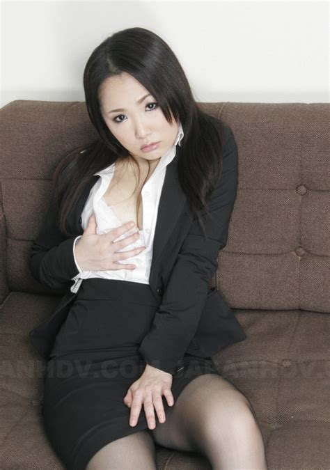 Asian Secretary Sits Down On The Sofa And Doffs White