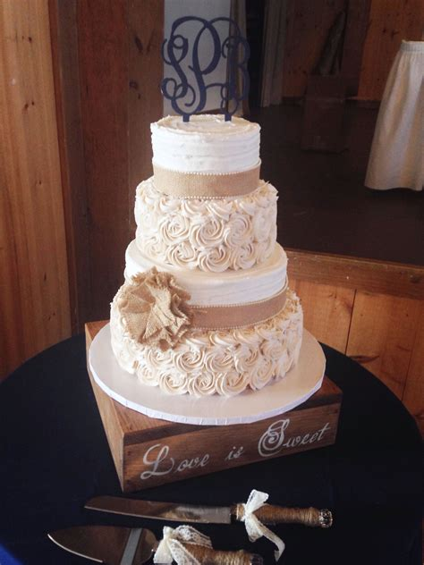 rustic wedding cake with burlap and buttercream rosettes