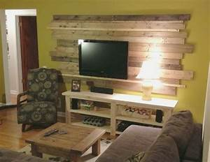 wood planked pallet accent wall behind the TV (Remove and
