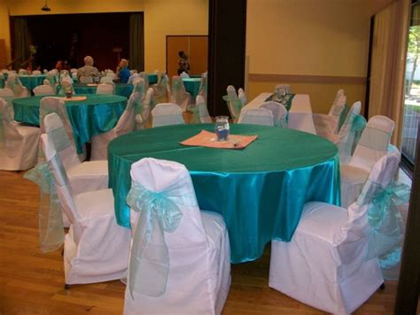 satin turquoise tablecloth and organza sashes around