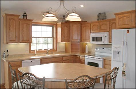 kitchens with oak cabinets and white appliances returns to area builds new home in lake 9858