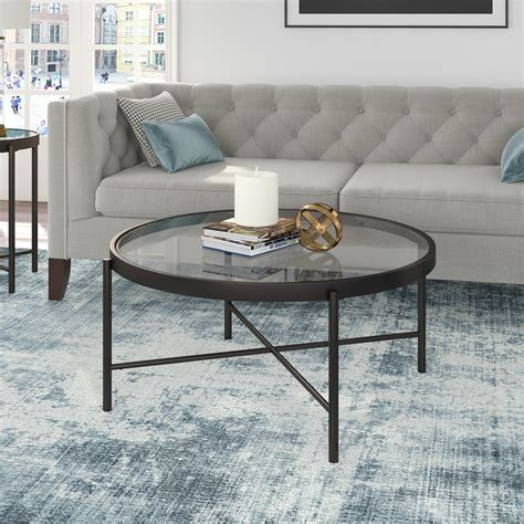Usually people think that a round glass coffee table is too small for their home or living room so for them, not properly fit but that is not true. Modern Round Glass Coffee Table, Cocktail in Blackened ...