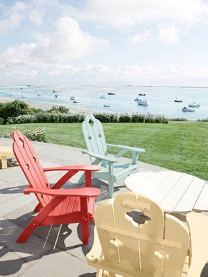 oceanfront patio with colorful adirondack chairs stylish