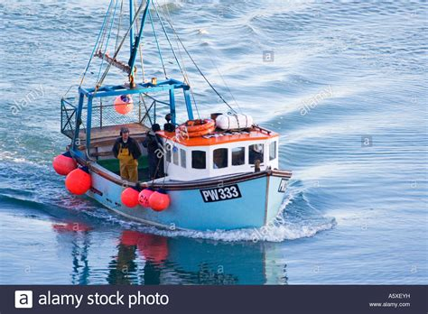 Fishing Boat Uk fishermen in a blue fishing boat trawler padstow