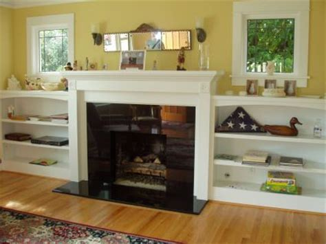 bookcases next to fireplace built in shelves around fire place loved this fireplace
