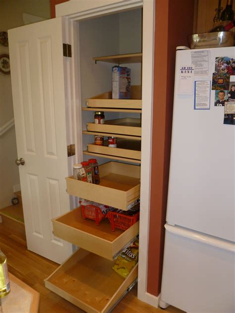 storage racks  white stained wooden frame pantry