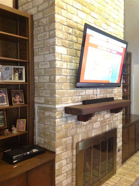 tv wall mounting   brick fireplace  ernesto wall