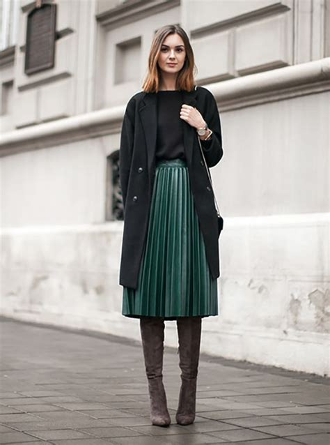 picture  pleated emerald skirt  black sweater tall suede boots   black coat